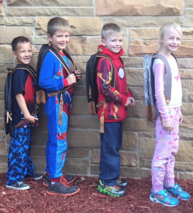 Gier Elementary School students pose with their backpacks. Scott McClallen/Collegian