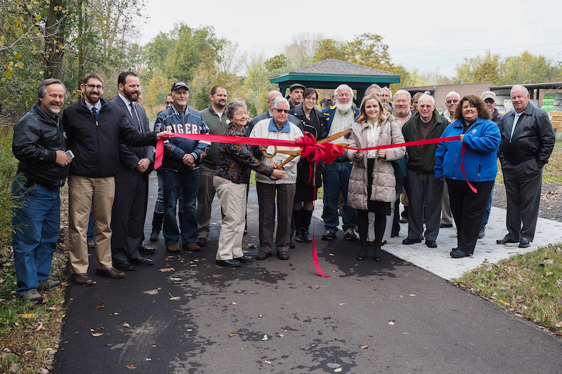 Community leaders and Jonesville area residents pose during the Rail Trail ribbon cutting.  Larry Jose | Courtesy