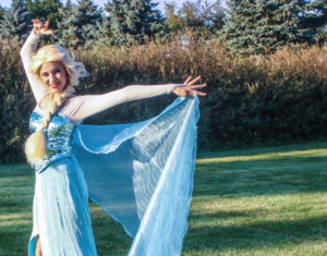 """Senior Gianna Marchese models as Disney princess Elsa from """"Frozen."""" On Wednesday, three students dressed up as Disney princesses to ring the bell for Salvation Army at Jonesville's Wal-Mart. Gianna Marchese 