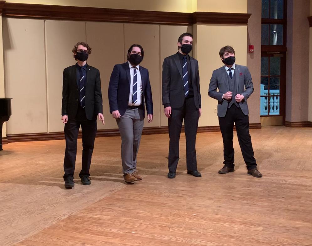 Members of Mu Alpha perform in a quartet. Courtesy   Mu Alpha