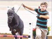 A young Tyler Conrad runs with his horse at a competition. Courtesy | Tyler Conrad