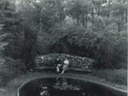 Two students sit together in the Slayton Arboretum. Courtesy   Hillsdale Alumni Magazine