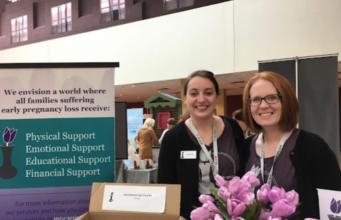 EPLA Secretary Maria Servold and President Emily Carrington at a pregnancy and infant loss conference in 2018.