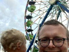 Ian Church holds his son at the Hillsdale County Fair. Courtesy | Ian Church